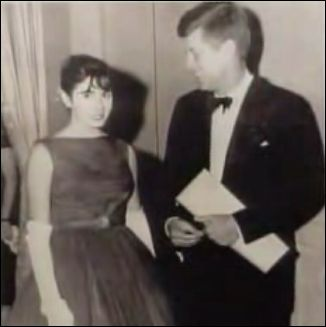 jfk looking down pelosi dress.jpg
